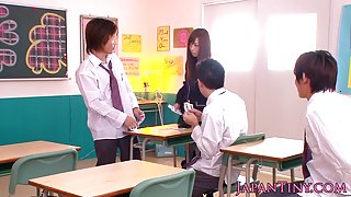 Japanese schoolgirl wanking and sucking cock