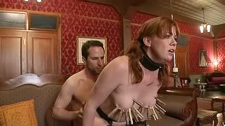 Redhead girl in stockings sucks a cock in a bondage video