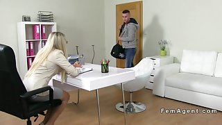 Female agent in stockings fucking on the couch